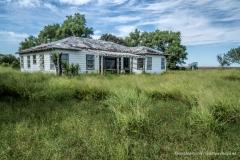 Abandoned Farm House and Ford Econoline Motor north of Corpus Christi